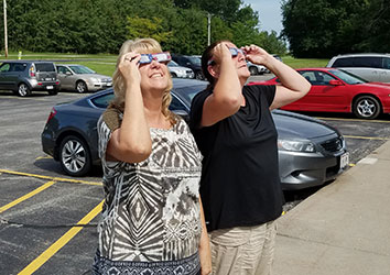 Schneider Supply Chain checking out the solar eclipse