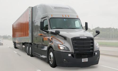 Schneider VTL Truck driver driving down highway.