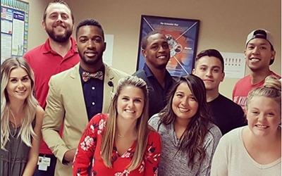 Schneider associates posing for a photo