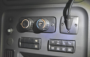 The 2022 Freightliner Cascadia APU control panel features climate control options, automotive power socket and a light.