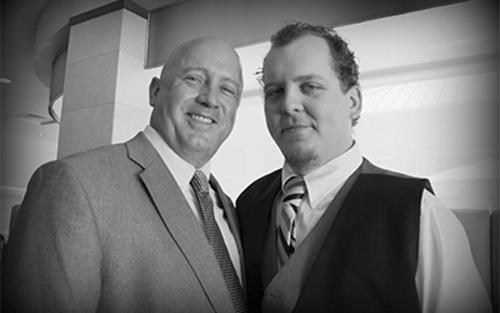 Father and Son Schneider Drivers David and Devon Price