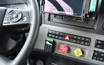 A small SmartDrive keypad is attached to the dash of the vehicle and can be seen behind the steering wheel.