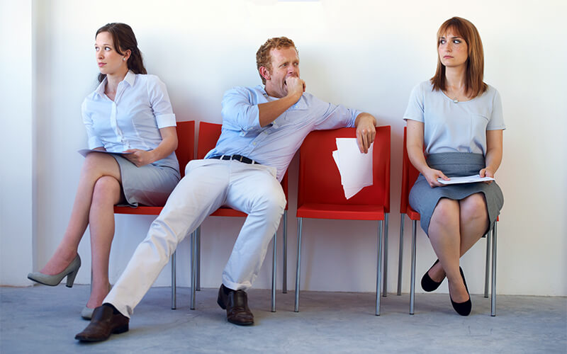 A candidate displays what not to do in a job interview.