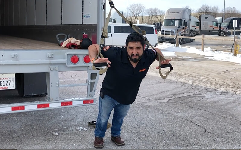 Dan does chest exercises as part of his truck driver workout.