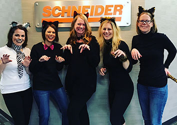 Schneider's Human Resource Team dresses up as cats for halloween
