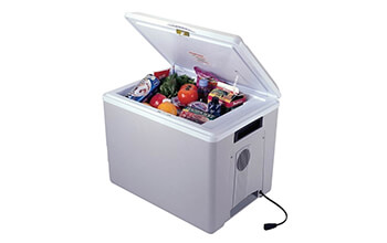 A Koolatron P75 Kool Kaddy Electric Travel Cooler is open, showing off a variety of different foods and drinks inside it.