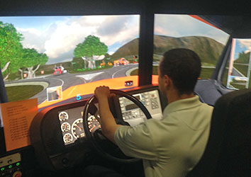 Day in the Life of a Schneider Operations Career - Operating associate trying out the truck simulator