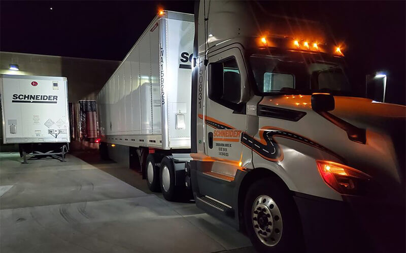 Truck parked at a loading dock with no-touch freight