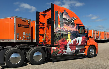 """The 2020 Canada Ride of Pride truck features a field of poppies, the Canadian flag, the yellow ribbon of remembrance and the motto """"Lest We Forget"""" in both English and French."""