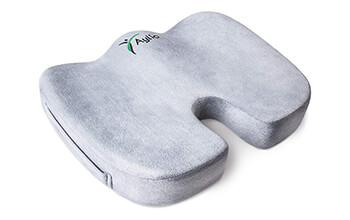The Aylio Coccyx Orthopedic Comfort Foam Seat Cushion is a U-shaped, grey cushion that has curves to conform to the user's bottom.