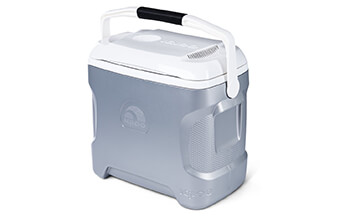 An Igloo Iceless 28 Quart Thermoelectric Cooler has the lid closed and the handle up, ready to be carried wherever it needs to go.