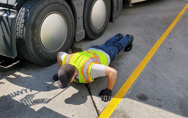 Truck driver performing pushups