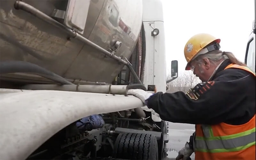 Schneider Tanker truck driver Wesley Buck looks over his bulk trailer while doing a pre-trip inspection.
