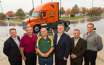 Mike Darras was part of Schneider's 25,000th Freightliner truck celebration.