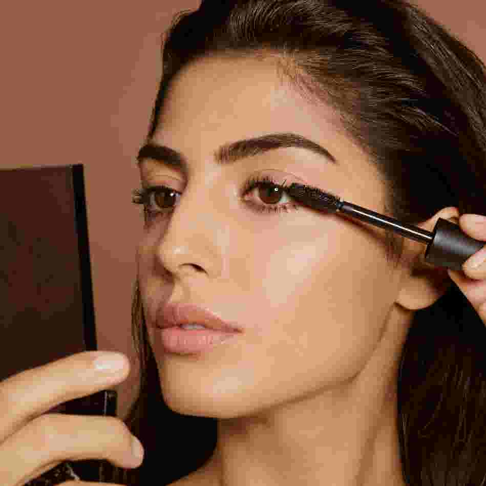 Model applying a Max Factor mascara.