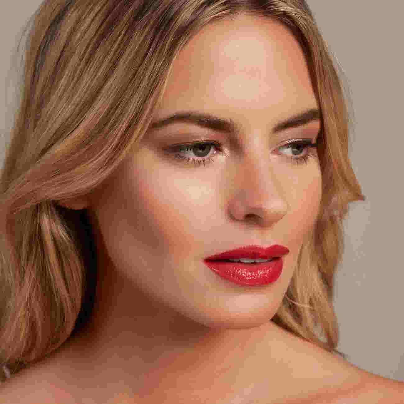 Model wearing Max Factor Colour Elixir Lip Cushion in Baby Star Coral