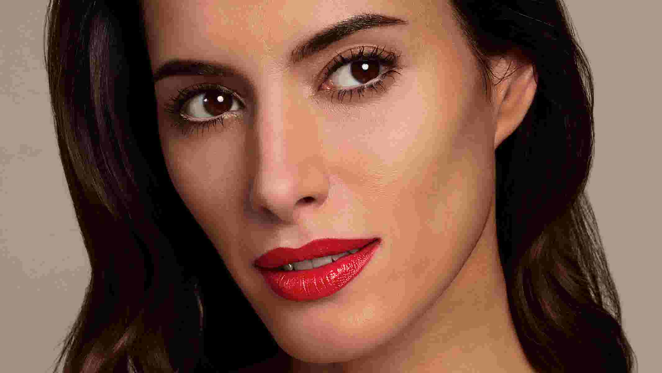 Photo of model wearing red long-lasting lipstick by Max Factor