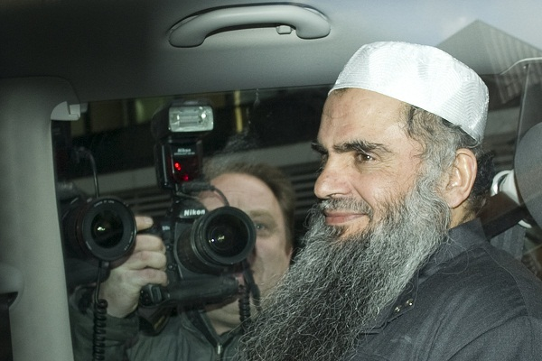 Abu Qatada smiles as he evades deportation once again in April 2012. (MIGUEL MEDINA/AFP/GettyImages)
