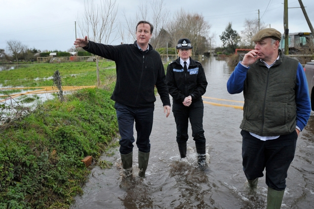 The wellies were off at PMQs, but flooding still dominated (Photo: Tim Ireland/AFP/Getty)
