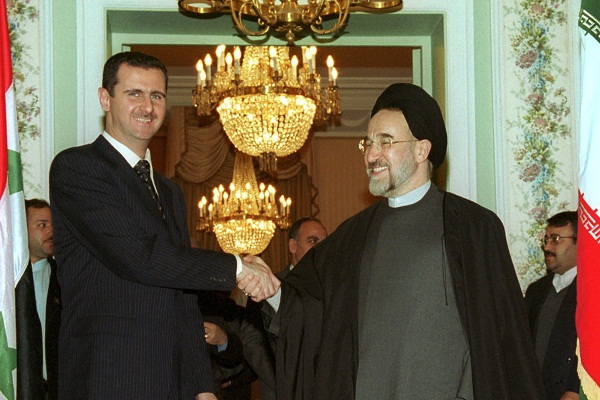Bashar Assad, back when he was a 'goodie', meeting President Khatami of Iran in 2001. Image: Getty.