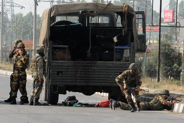 Indian soldiers take cover during fighting in Kashmir in September 2013. (ROUF BHAT/AFP/Getty Images)