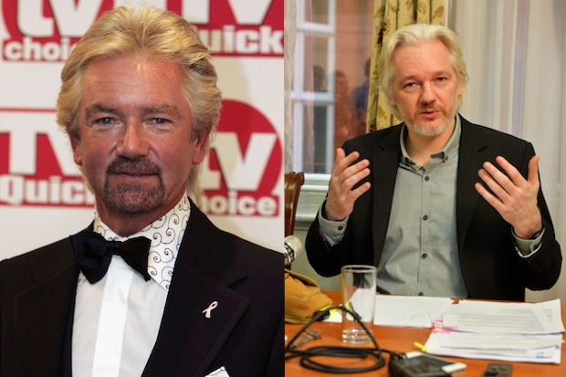 Has turned into a hermit with Noel Edmonds' hair: Julian Assange (right). Images: Getty