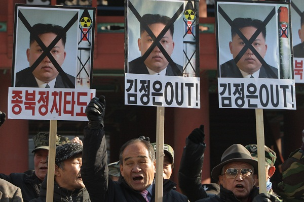South Korean conservative protesters participate in an anti-North Korea rally reacting to North Korea launching the long-range missile on December 12, 2012 in Seoul. Image: Getty