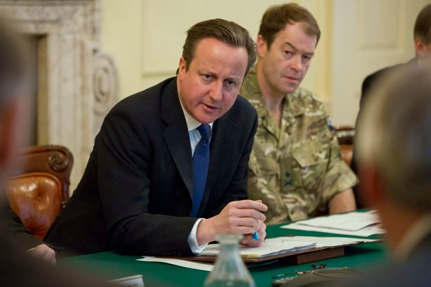 An incompetent response to the floods could lose Cameron the 2015 election (Photo: Neil Hall/Getty