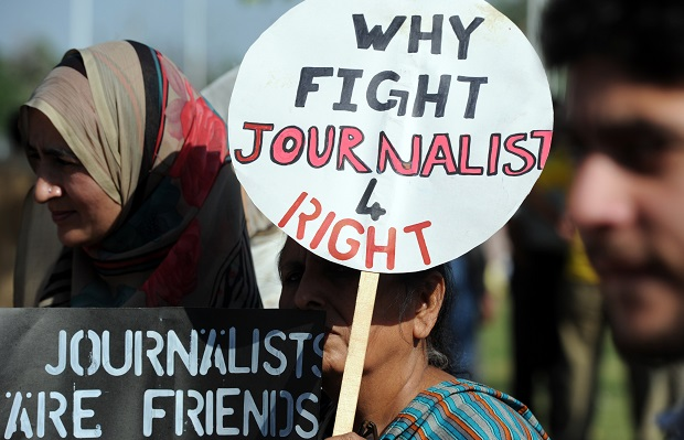 Pakistani journalists hold placards during a protest against the attack on Geo television journalist Hamid Mir by gunmen in Islamabad on April 23, 2014. (Image: AAMIR QURESHI/AFP/Getty Images)