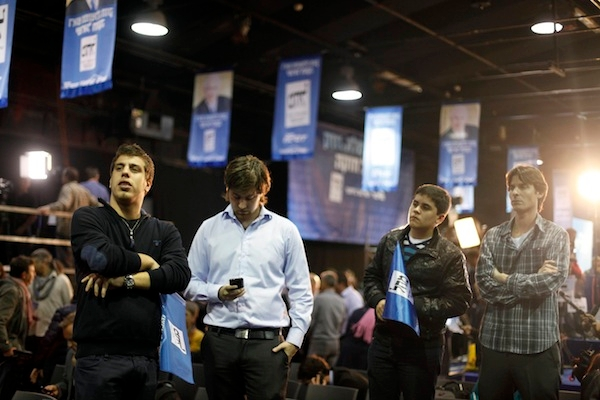 Supporters of Israeli Prime Minister Benjamin Netanyahu wait for election results at his election campaign headquarters. Picture: Getty