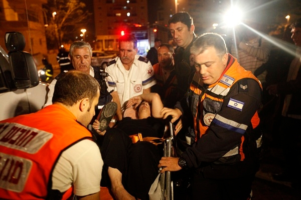 Israeli emergency services assist a wounded civilian yesterday morning, prior to the attack on Hamas. Image: Getty