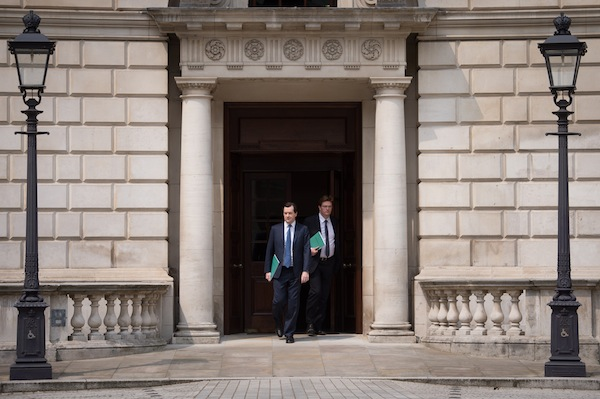 George Osborne and Danny Alexander leave the Treasury to deliver the spending review.