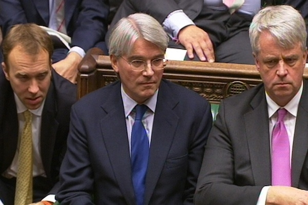 Matthew Hancock, left, gave Mitchell a reassuring pat on the shoulder after PMQs. The Chief Whip's position has been since reaffirmed by his colleagues. Photo: PA