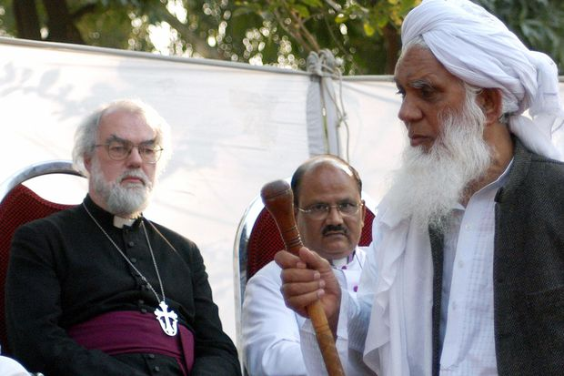 Former Archbishop of Canterbury Rowan Williams visiting an Islamic seminary during a trip to Pakistan in 2005. Image: Arif Ali/AFP/Getty Images