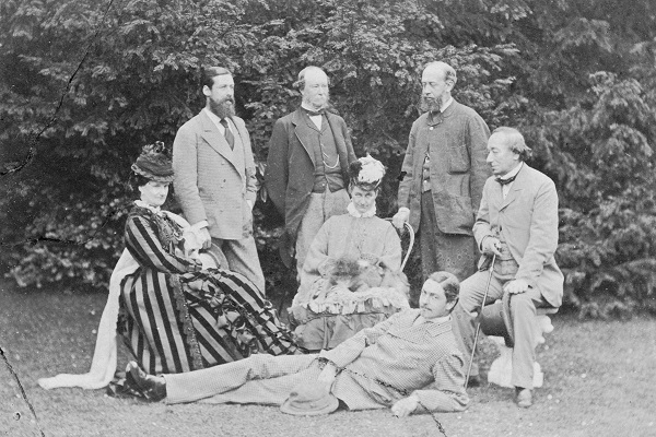 At home with Disraeli at Hughenden Manor, Buckinghamshire, 1874. Left to right: Selina Weld-Forester, Countess of Bradford, Montagu Corry, 1st Baron Rowton (1838 -1903), Orlando Bridgeman, 3rd Earl of Bradford (1819 � 1898), Susan Charlotte, Lady Wharncliffe, George Herbert, 13th Earl of Pembroke (1850 � 1895, foreground), Edward Montagu-Stuart-Wortley-Mackenzie, 1st Earl of Wharncliffe (1827 � 1899) and Disraeli. (Photo by Henry W. Taunt/Hulton Archive/Getty Images)