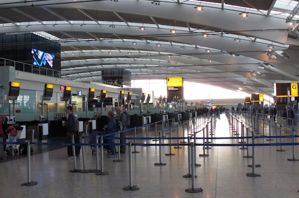 Passengers check in at quiet check in de