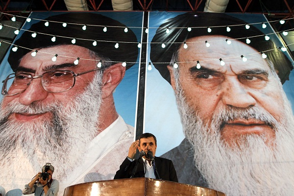 Iranian President Mahmoud Ahmadinejad delivers a speech under portraits of Iran's supreme leader, Ayatollah Ali Khamenei, and the founder of Iran's Islamic Republic, Ayatollah Ruhollah Khomeini. Getty: Image.