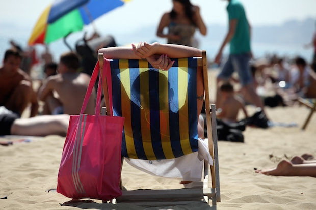 A sunbather in the UK producing vitamin D. Image: Getty