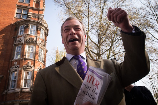 Nigel Farage brandishing the Spectator today. Photo: PA.