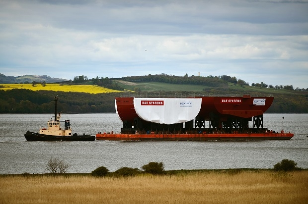 A section of HMS Queen Elizabeth II being towed up the Clyde. (Image Getty)