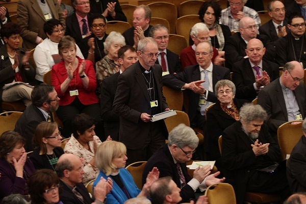 Justin Welby returns to his seat after addressing the General Synod of the Church of England, which includes the House of Laity. Image: Getty