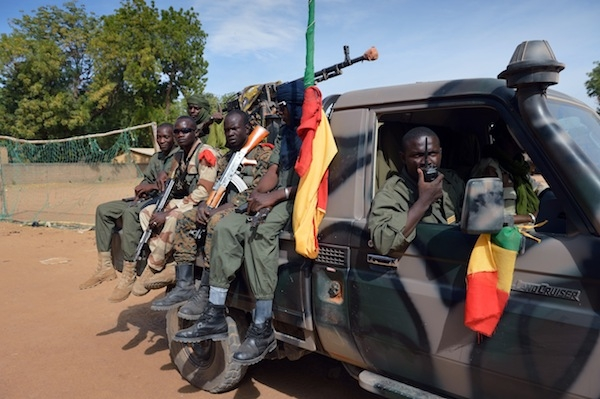 Malian soldiers patrol in a street of Diabaly. Picture: Getty