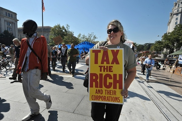 A woman campaigns for the taxing of rich people at an Occupy protest. Picture: Getty.