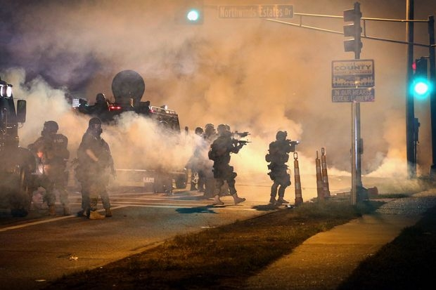 Police attempt to control demonstrators protesting the killing of teenager Michael Brown on August 18, 2014 in Ferguson, Missouri. Image: Scott Olson/Getty Images