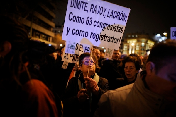 Protesters hold placards reading 'Rajoy thief, resign'. Picture: Getty Images