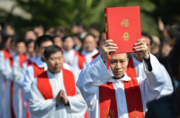 The Chinese state is terrified by the spread of Christianity. (PETER PARKS/AFP/Getty Images)