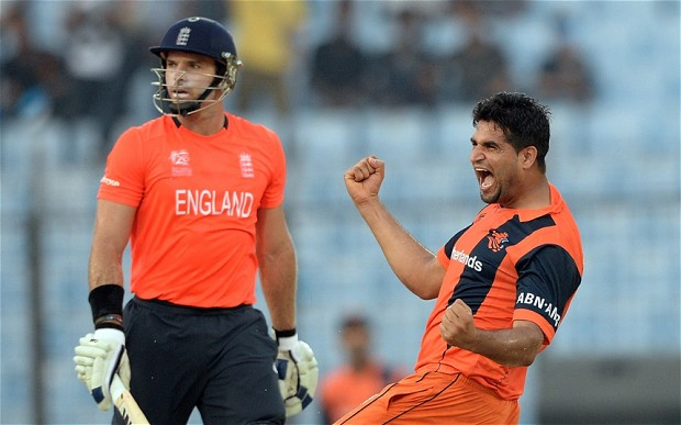 Holland bowler Mudassar Bukhari celebrates the wicket of England's Michael Lumb. Photo: AFP / GETTY IMAGES