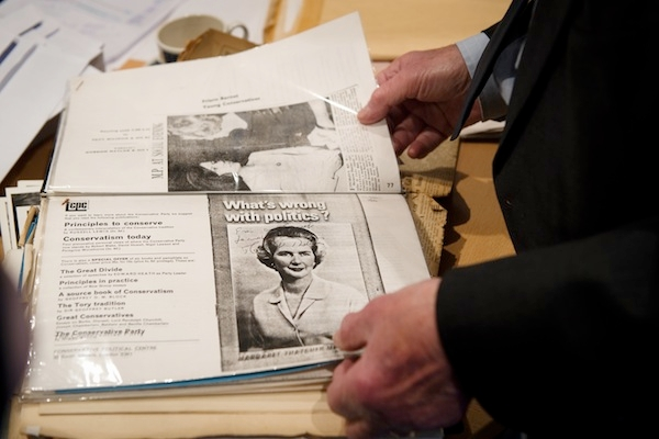 Members of staff look through old newspaper cuttings from Margaret Thatcher's time as an MP. Picture: Getty