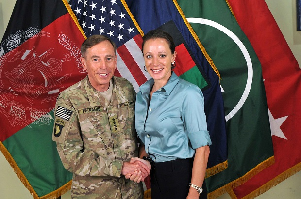 Gen. David Petraeus shakes hands with biographer Paula Broadwell. (Image: ISAF via Getty Images)