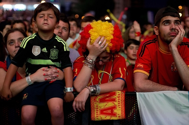 Spanish fans in Madrid try and fail to suck up their team's defeat. (Photo by Gonzalo Arroyo Moreno/Getty Images)